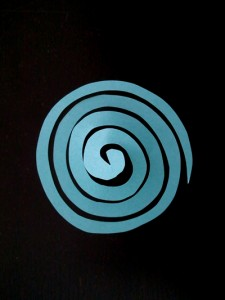 Thin out the swirl by cutting along the swirl in the middle.